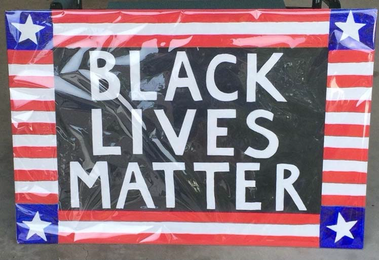 Black Lives Matter sign with patriotic flourishes