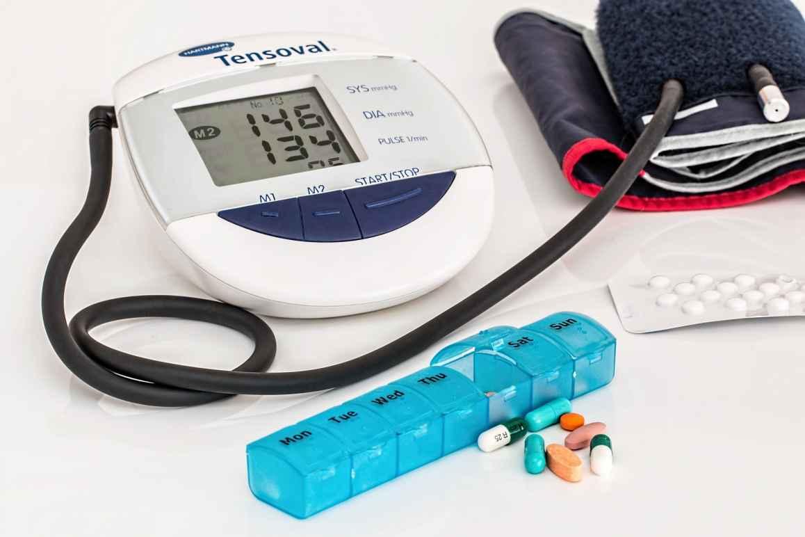 pills and blood pressure measurer