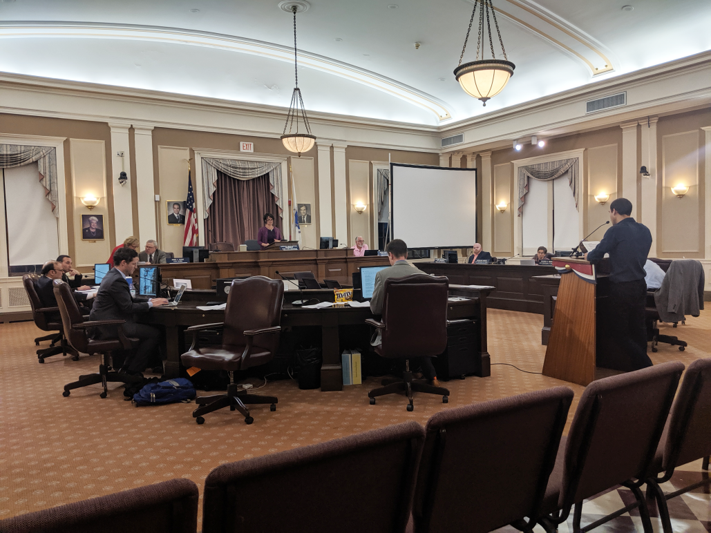 ACLU staff Emiliano Falcon testifies before the Somerville City Council in June 2019