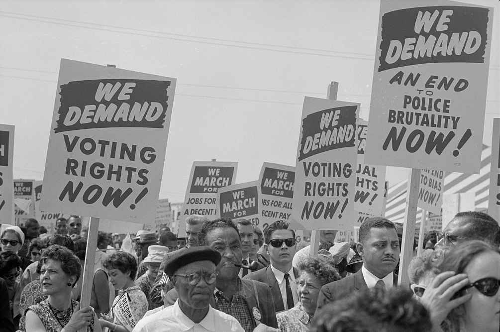 Marchers with signs at the March on Washington in 1963
