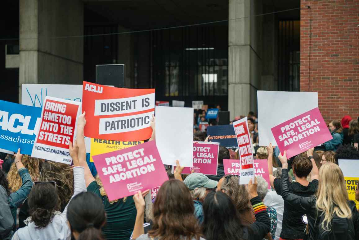 People rally outside Boston City Hall to oppose Judge Kavanaugh's nomination to the Supreme Court