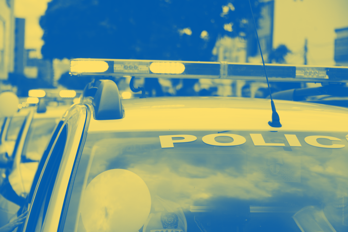 Blue and yellow color treatment on police car