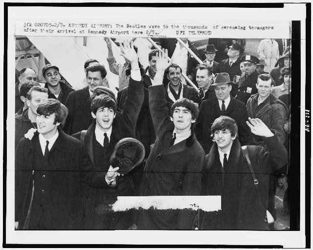 The Beatles enter Kennedy Airport February 1964