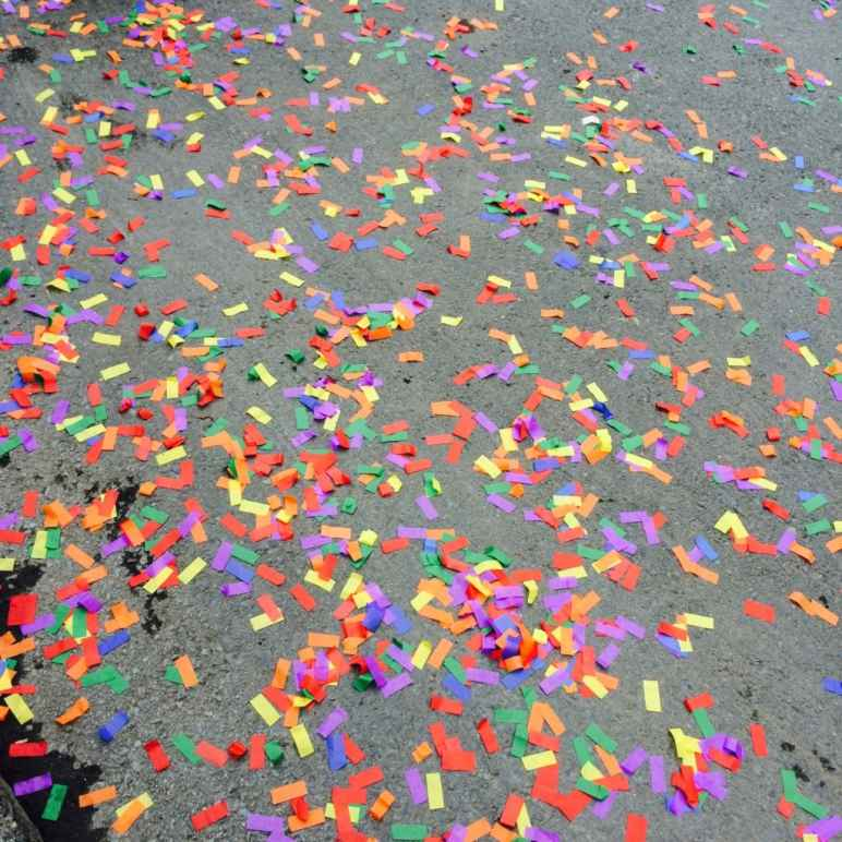 Rainbow confetti on ground Stock