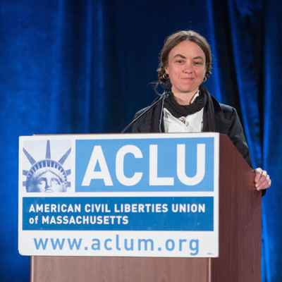 Wenzday Jane at podium with ACLU sign