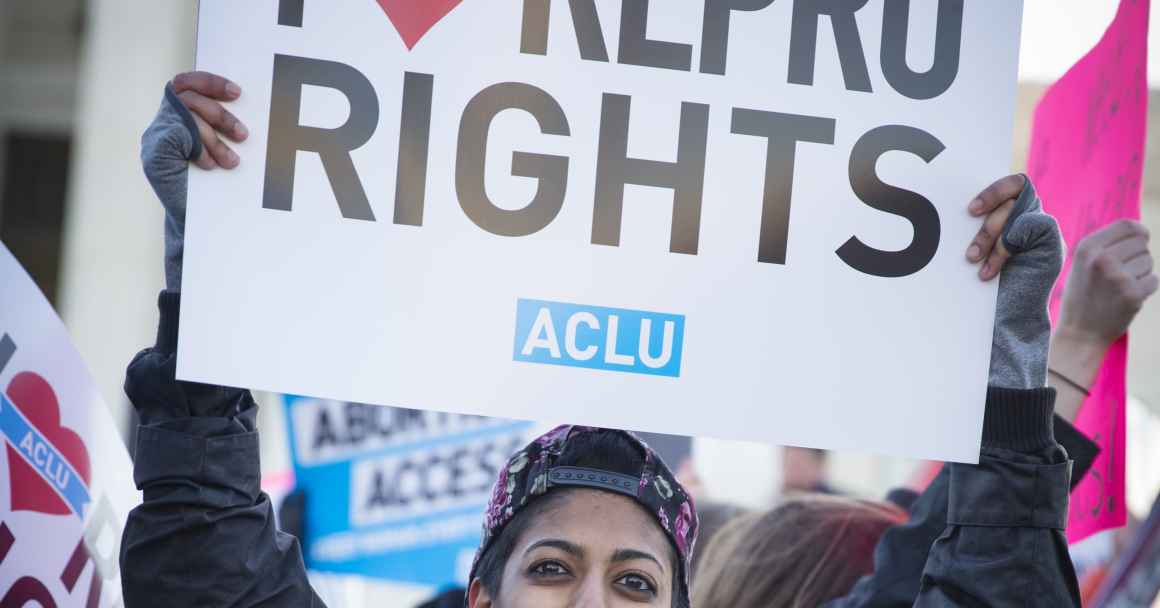 """Protester holding """"I Love Repro Rights"""" sign"""