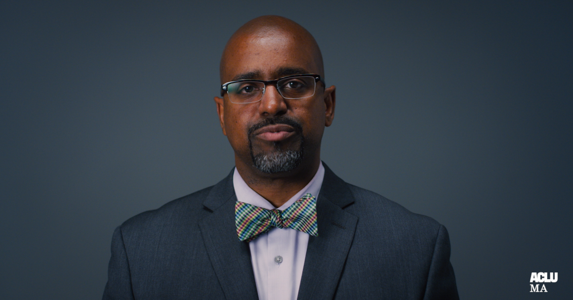 Rahsaan Hall, director of the ACLU of Massachusetts' Racial Justice Program and What a Difference a DA Makes campaign manager in front of a gray background
